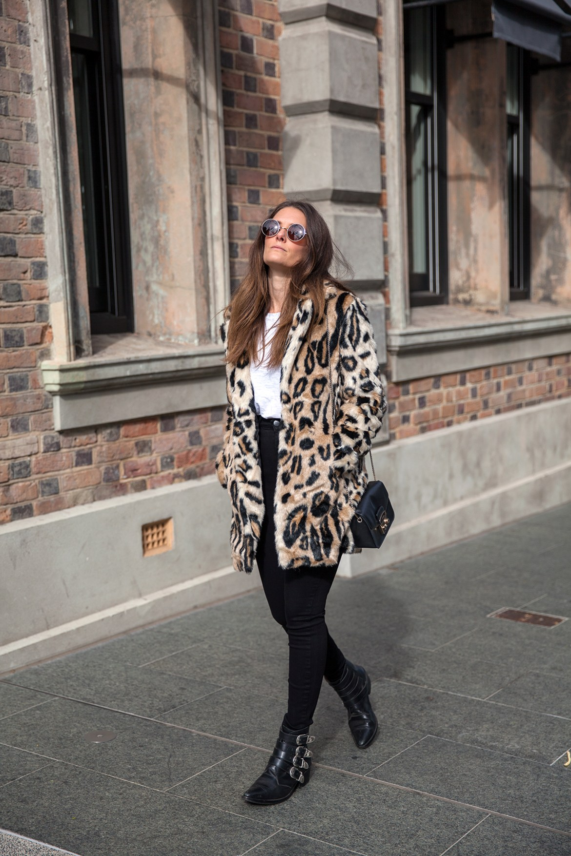 Bardot leopard fur coat worn with skinny jeans by street style blog Inspiring Wit