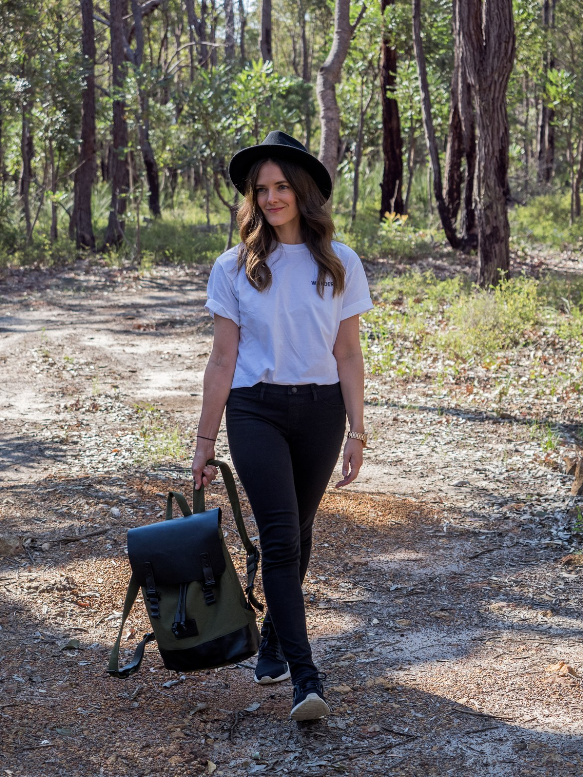 Gaston Luga Praper olive and black backpack worn by Inspiring Wit travel and fashion blogger with Will and Bear hat