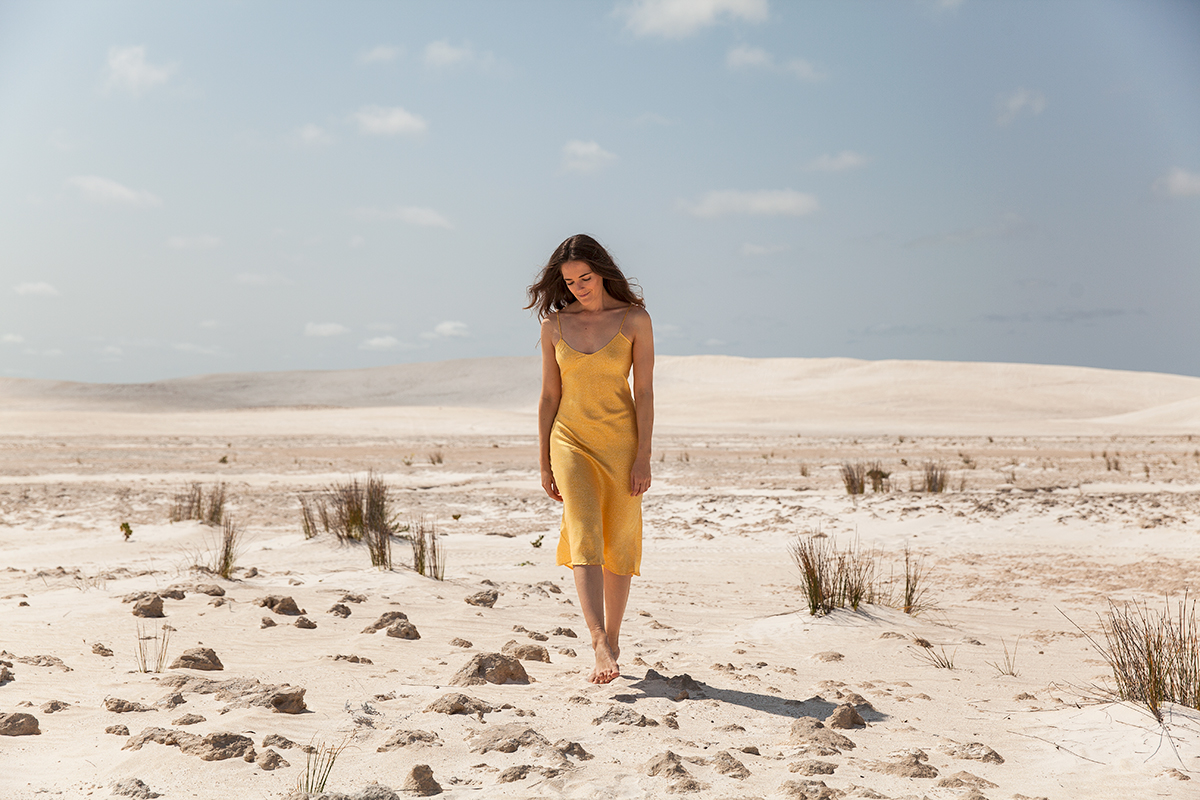 Silk Laundry slip dress in yellow worn by Jenelle of the fashion blog Inspiring Wit in sand dunes