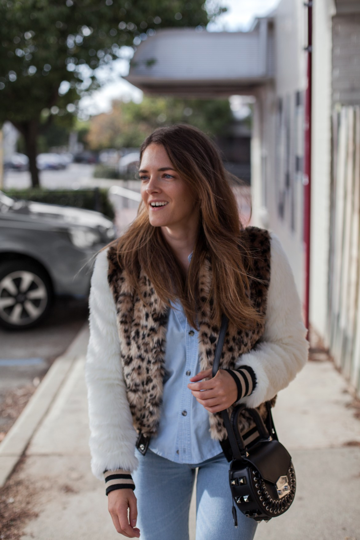 Mother The Baseball Snap Jacket faux fur leopard print with Levi's jeans and Salar black shoulder bag worn by Inspiring Wit blogger Jenelle Witty