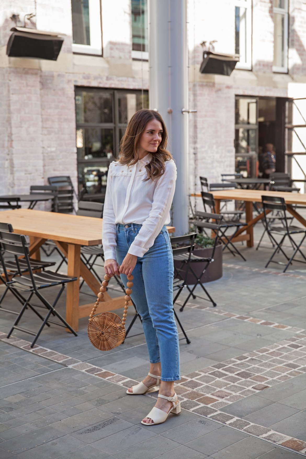 Everlane cheeky straight jean and block heeled sandal worn by Australian fashion blogger Jenelle Witty of Inspiring Wit with Cult Gaia circle bag and Maje blouse