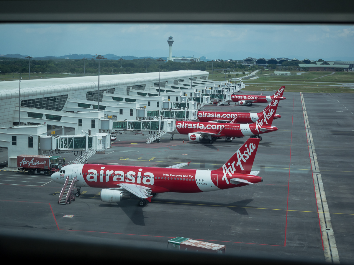 Planes at the Kuala Lumpur airport AirAsia review flying from Perth to Penang with travel blogger Inspiring Wit