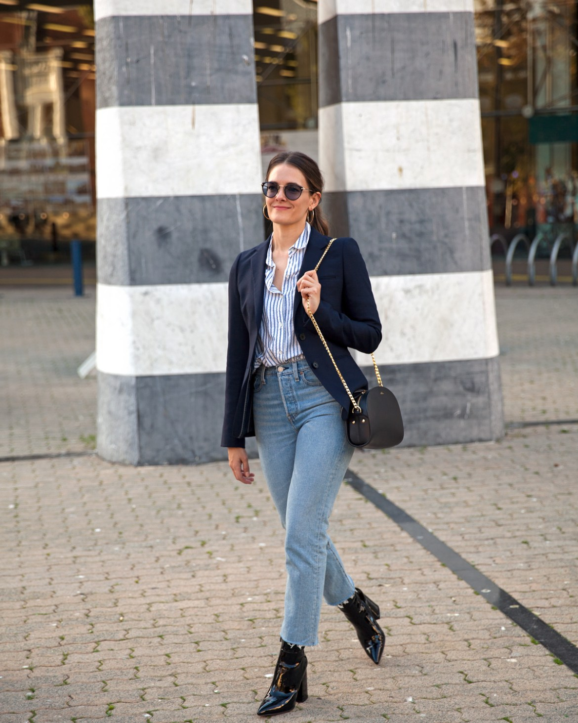 Transitions Colours Lenses worn with navy blazer, Levi's jeans, Alias Mae patent boots and A.P.C Luna Half Moon Bag by Inspiring Wit blogger Jenelle street style