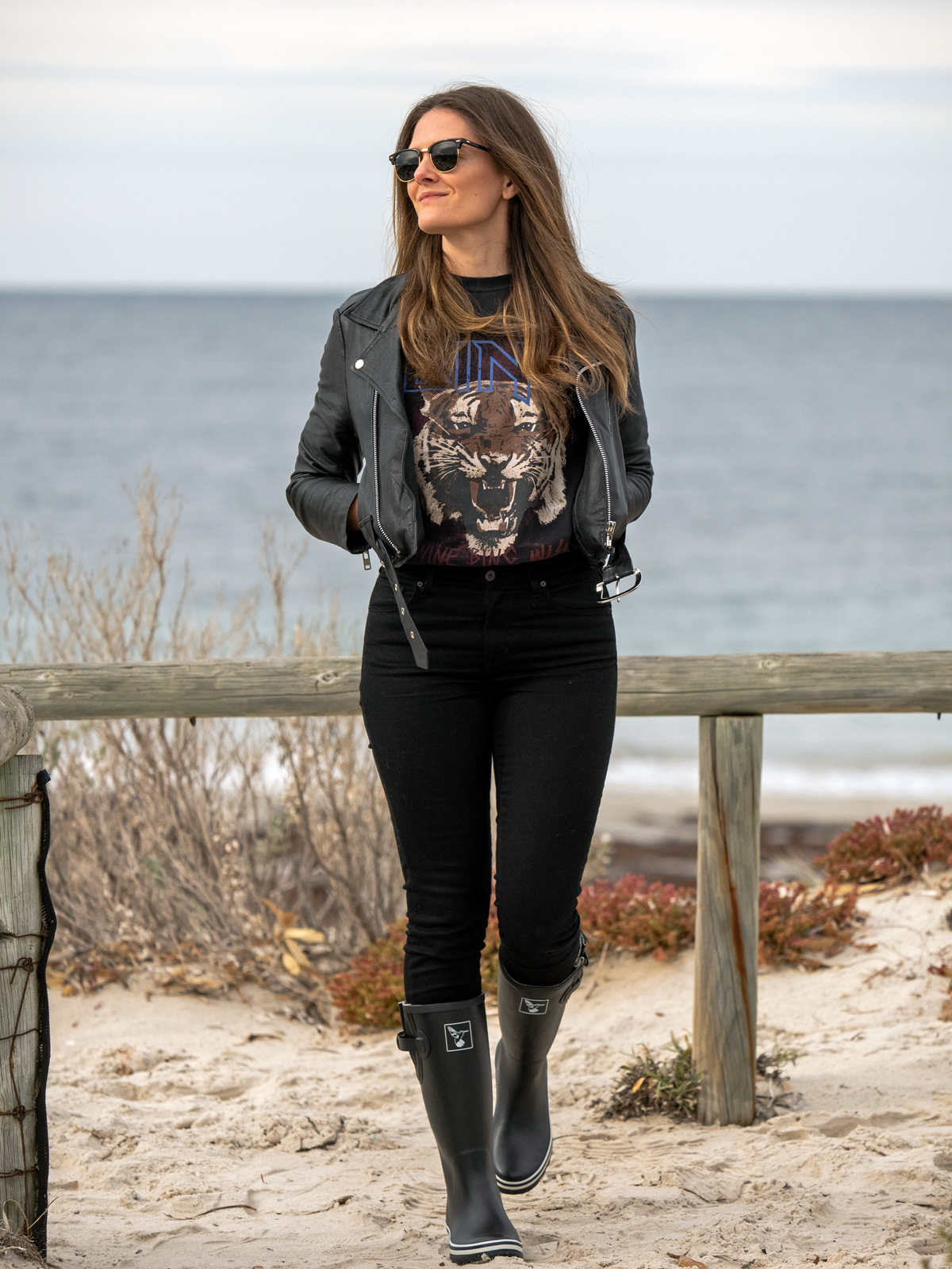 Winter outfit ideas black leather jacket, Anine Bing Tiger t-shirt, Mavi black skinny jeans, Evercreatures black gumboots worn by Inspiring Wit blogger Jenelle