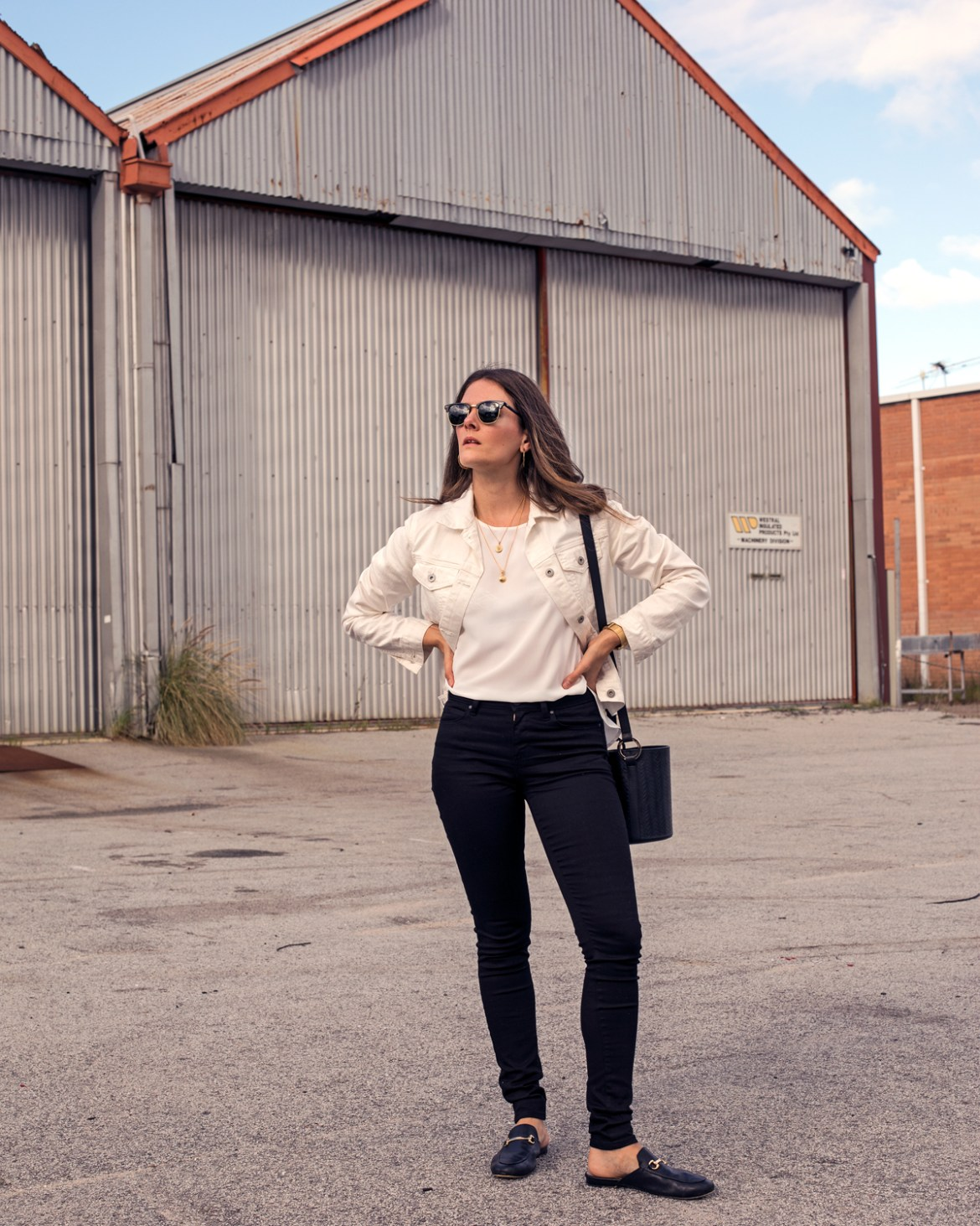 Uniqlo Perth is finally open! Fashion blogger Jenelle Witty from Inspiring Wit wearing Uniqlo rayon blouse with white denim jacket and black skinny jeans