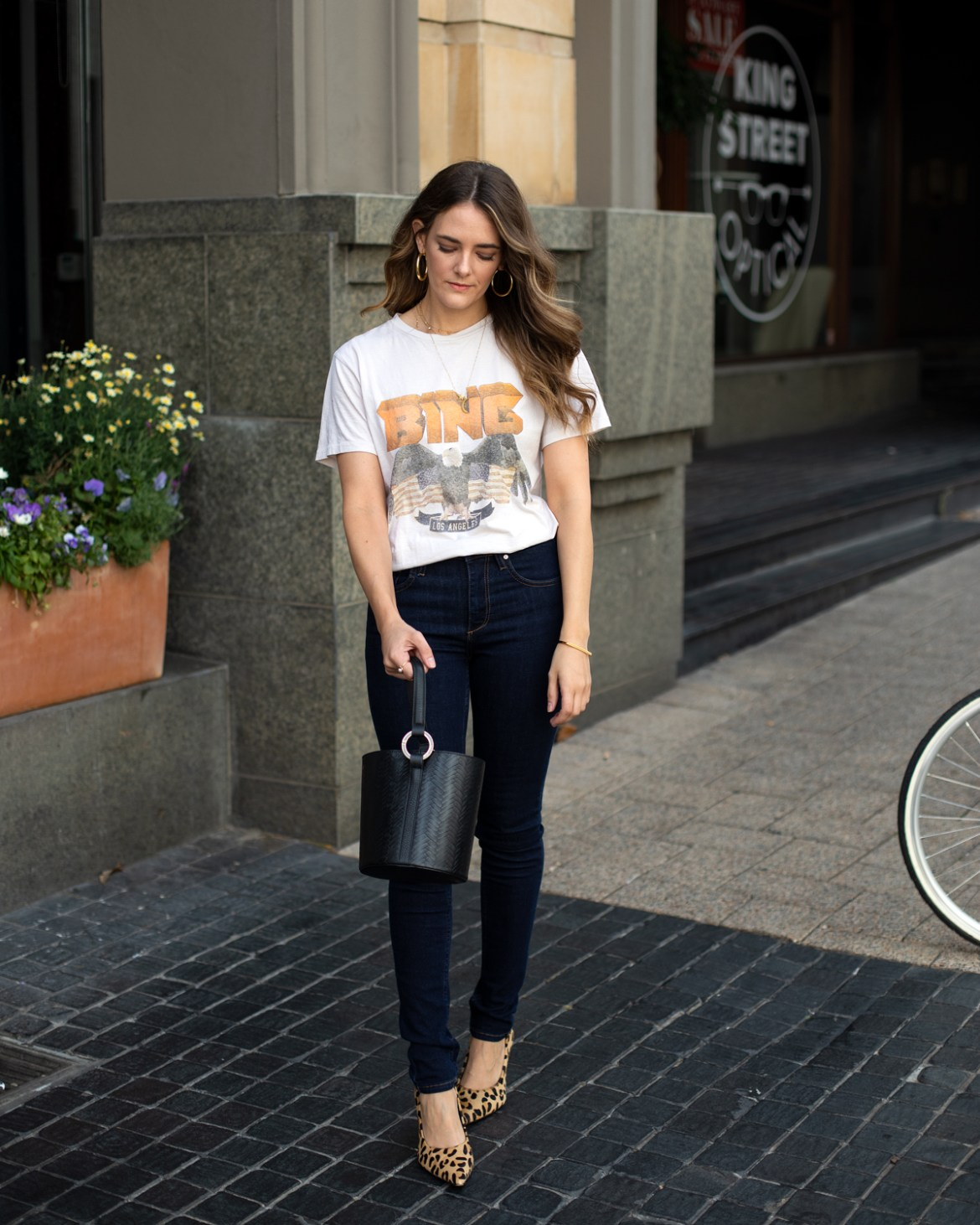 Anine Bing vintage tee outfit with Reiko skinny jeans and leopard print heels worn by fashion blogger Jenelle Witty from Inspiring Wit from a blog post talking about big little goals for 2019