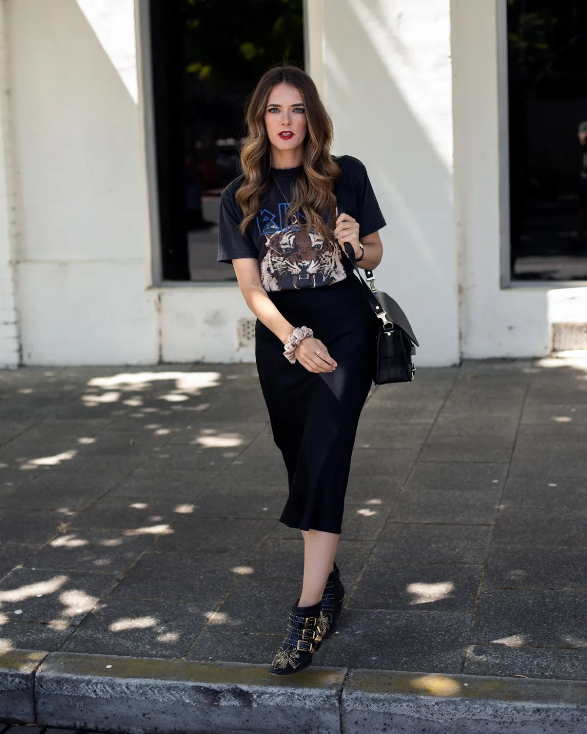 Anine Bing vintage tee with lion print and silk slip skirt worn with Chloe studded boots and Proenza Schouler PS11 bag