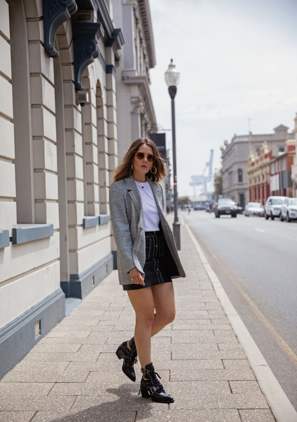Anine Bing Madeline Blazer in check worn by Inspiring Wit with Shrimps beaded bag, Aje leather Shrimpton Mini skirt, Jac + Jack tee and Chloe Rylee boots