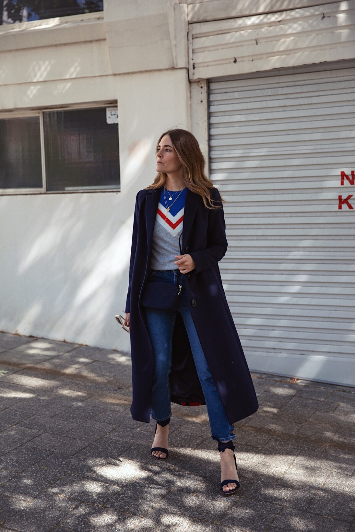 Boden street style outfit with navy coat, suede heels, cashmere knit, cat-eye sunglasses and jeans worn by Inspiring Wit fashion blogger Jenelle
