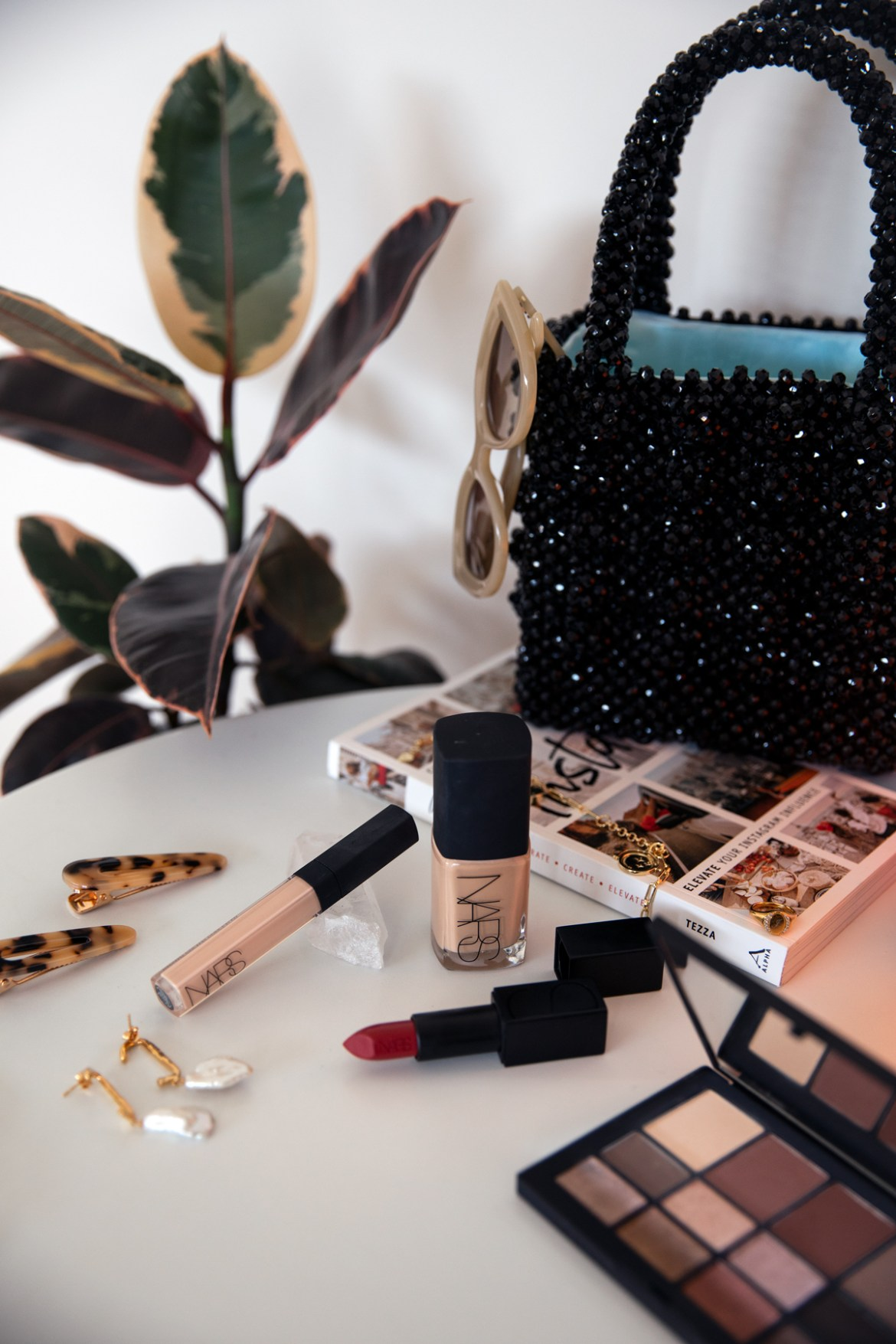 Nars Sheer Glow foundation, lipstick, eye shadow palette and concealer from Mecca by Inspiring Wit with beaded Shrimps bag and Valet hair clips
