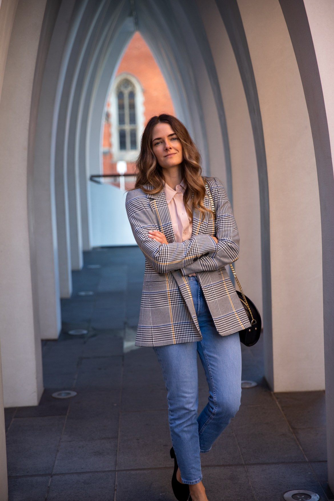 capsule wardrobe items in one repeat wearable outfit for any season with an Anine Bing check blazer jeans and a button down shirt worn by Inspiring Wit fashion blogger Jenelle