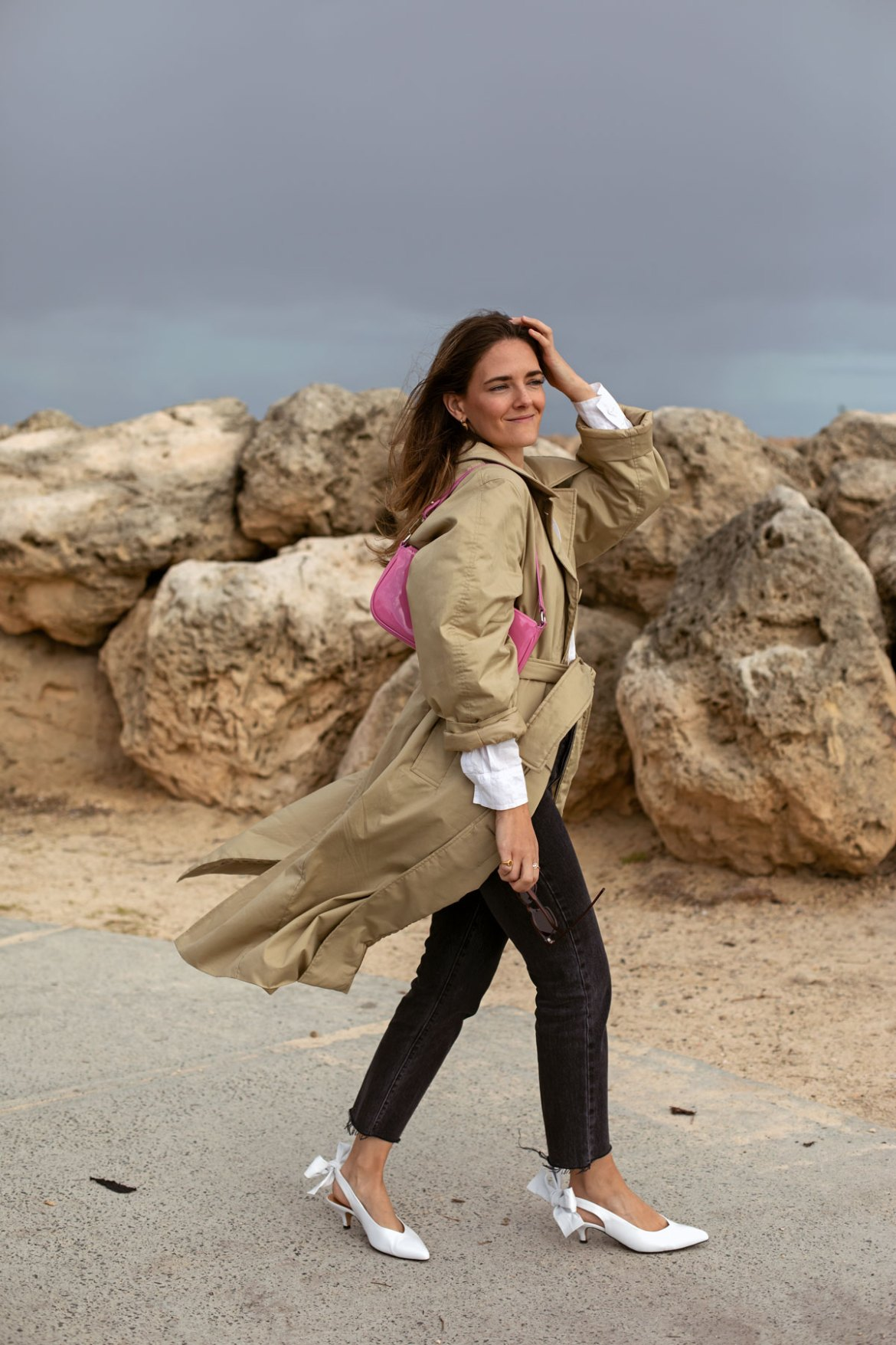 Winter outfit idea with trench coat and pink baguette bag