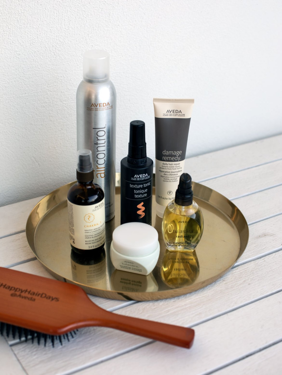 tray of hair and body care products from Aveda