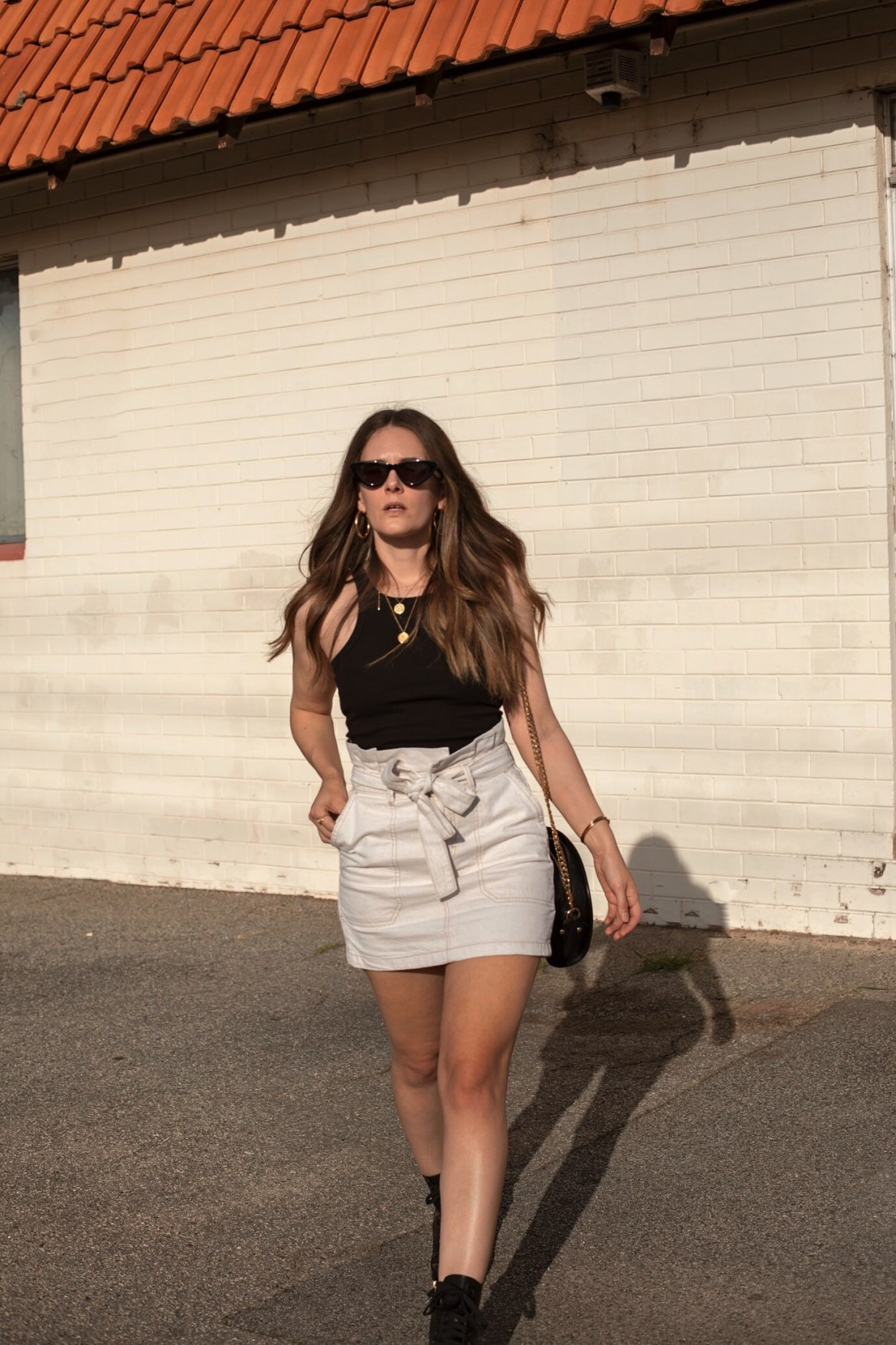 black tank top and cream mini skirt outfit idea