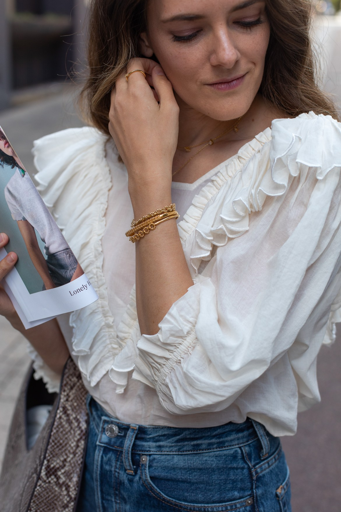 ruffle detail on Innika Choo blouse worn by luxury fashion blogger from Australia Jenelle Witty of the blog Inspiring Wit