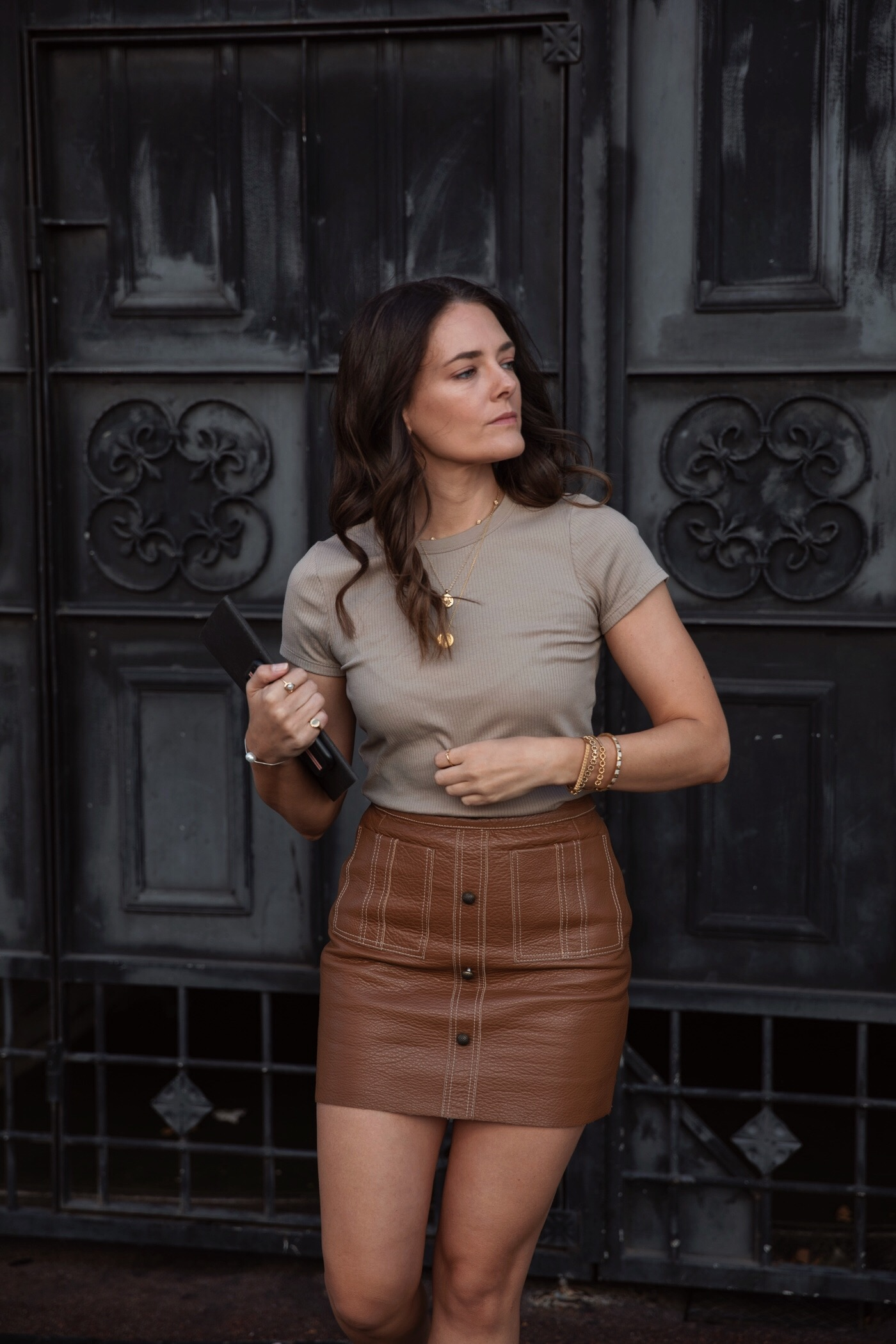 warm neutrals outfit with leather skirt