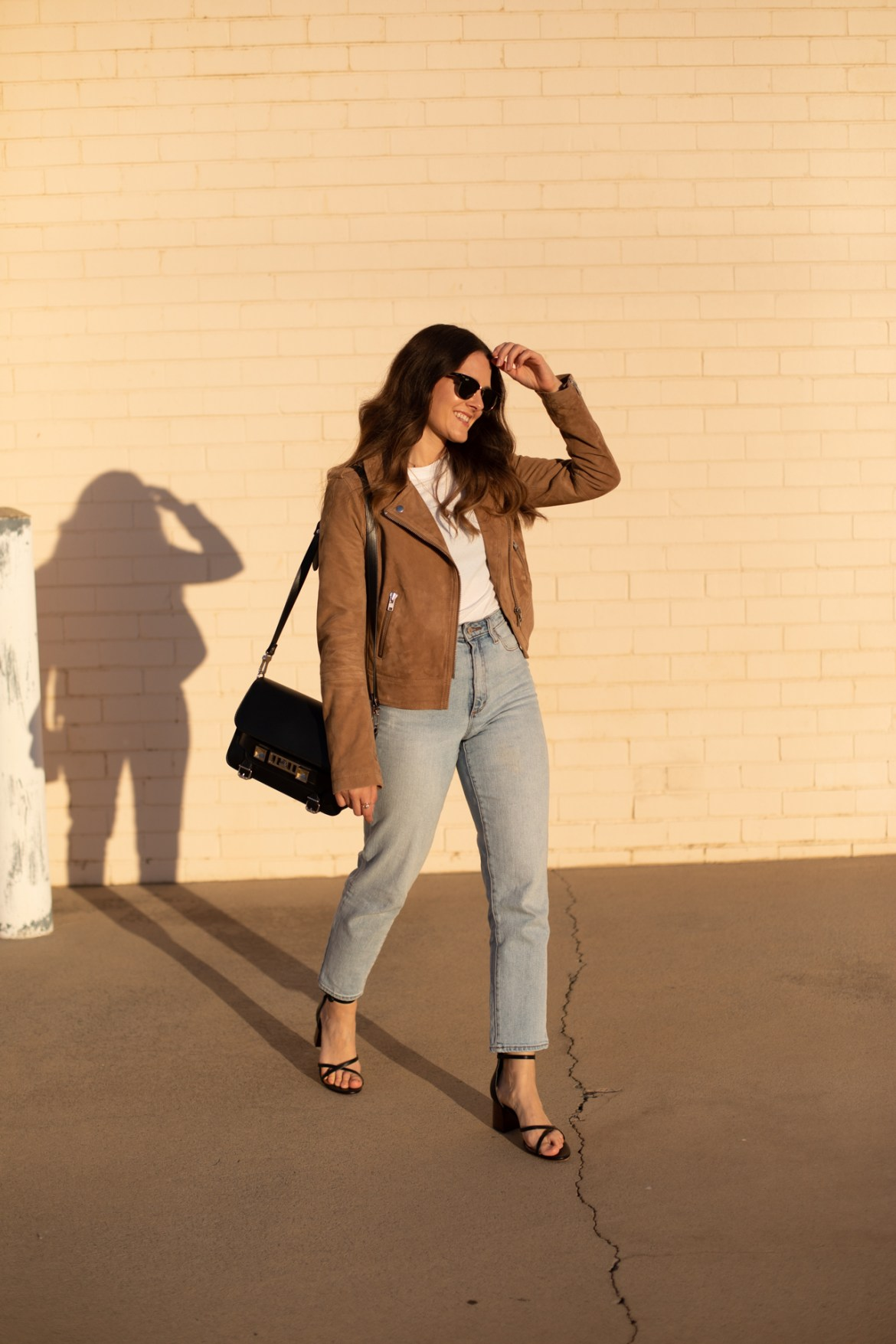 outfit with strappy heels a suede brown jacket and jeans