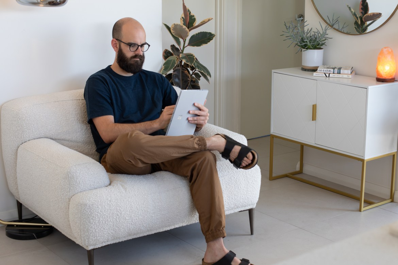 graphic designer Mario Recchia in the boucle armchair from Brosa