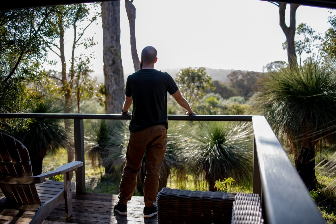 Mario looking out over the bushland from the timber deck