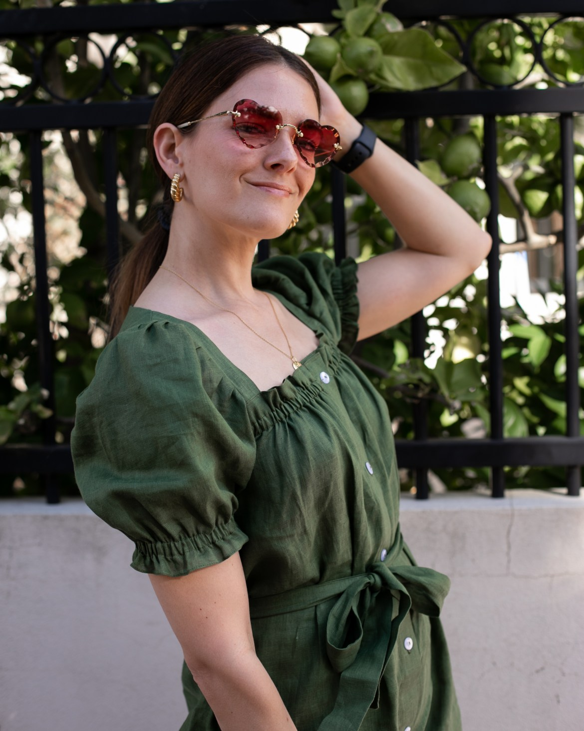 cottage core inspired linen dress from Sleeper in green is a perfect summer update.