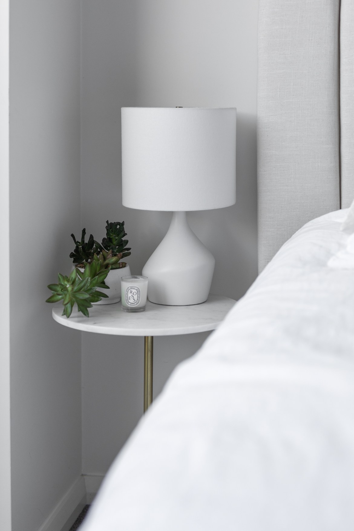 How to style a white marble bedside table