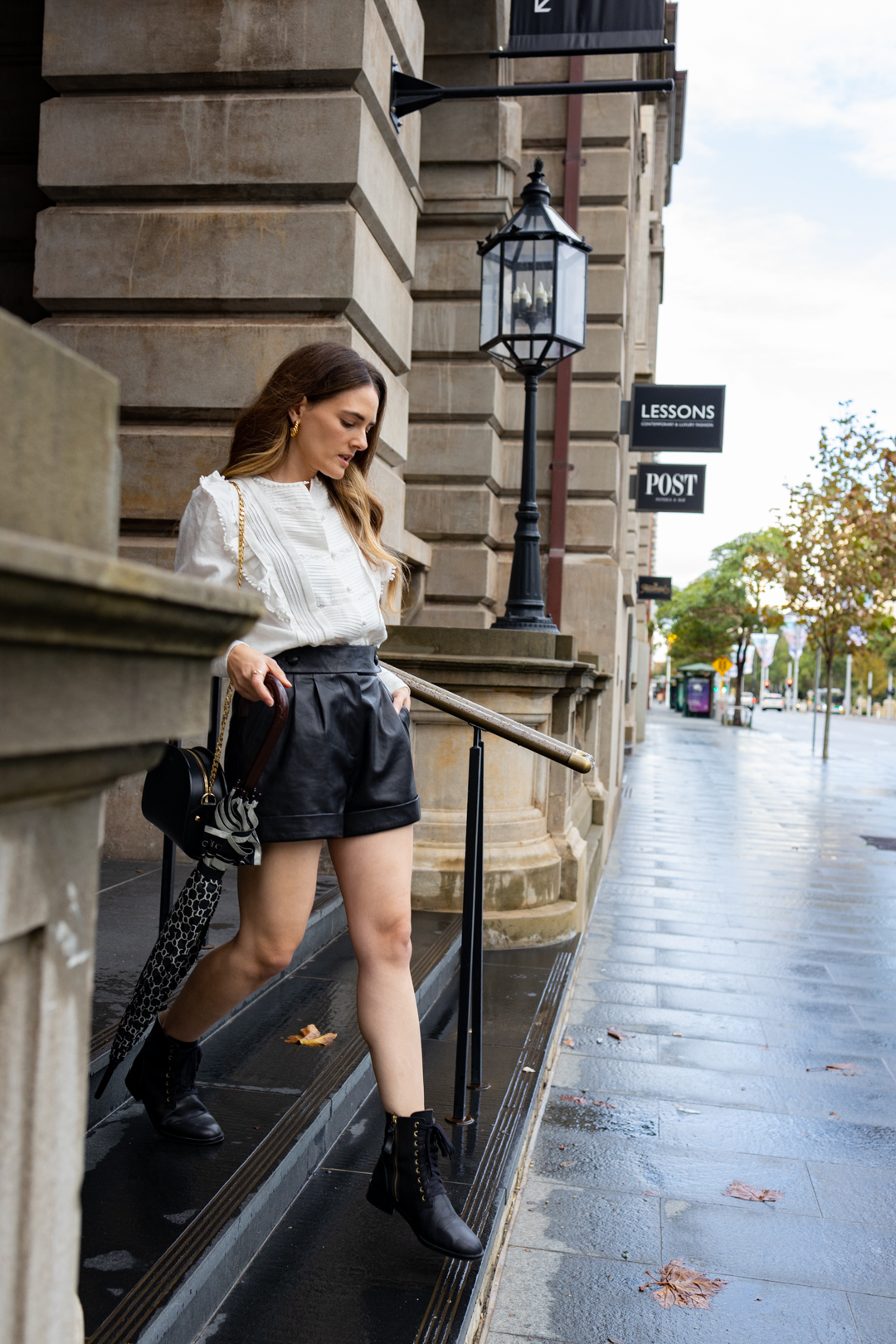 Black leather shorts and boots outfit