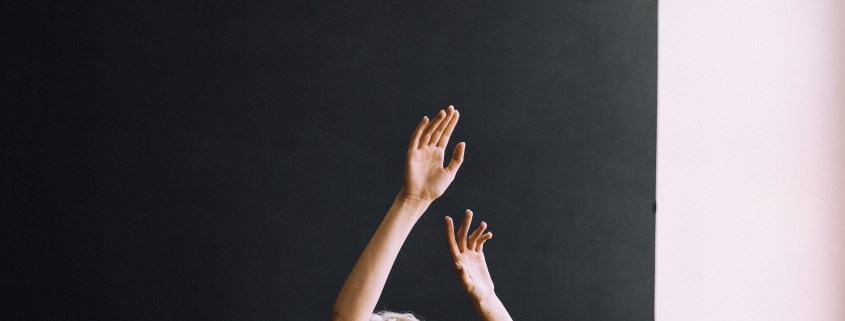 Image of raised hands