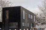 Prefab huis met PVT-panelen als bron voor een warmtepomp