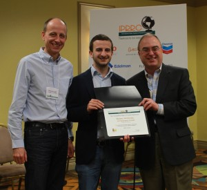 Simone Mariconda, Francesco Lurati accept IPRRC Top Paper Award from Frank Ovaitt