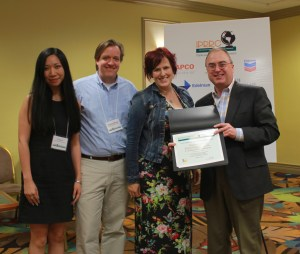Yan Jin, Marcus Messner, Jeanine Guidry accept IPRRC Top Paper Award from Frank Ovaitt