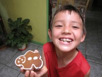 Homestay Kid eating Gingerbread for the first time