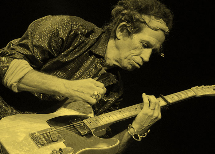 Rolling Stones guitarist Keith Richards plays his electric guitar