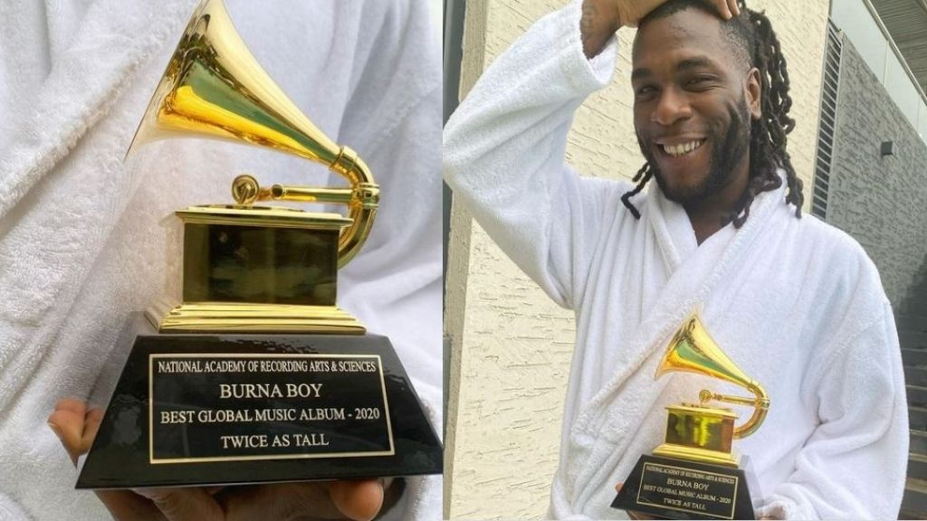 Burnaboy says as he shows off the Grammy Awards Plaque he just received