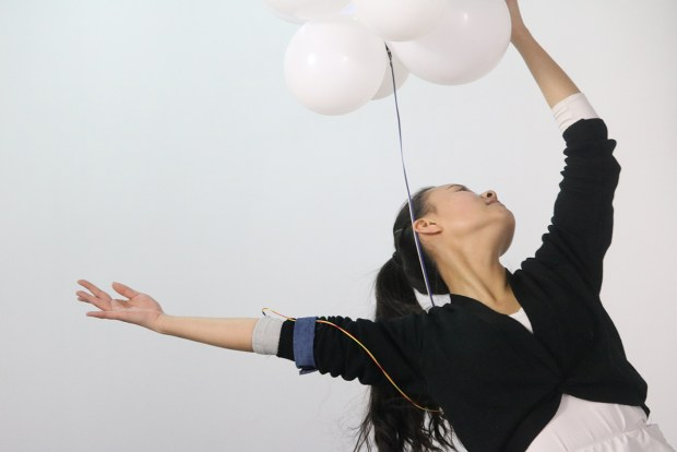 Cloudscape - A dancer performs while wearing the 'balloon' interface.