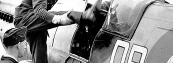 Douglas Bader climbs into the cockpit of his Spitfire. Imperial War Museum