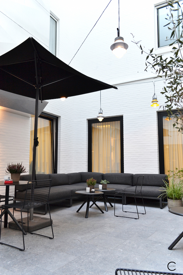 Outdoor Lounge spot with black wire chairs and tables by HAY | Ink Hotel Amsterdam | Tried + Tested | Design Hotel | Boutique Hotel | Picture © By C-Mo