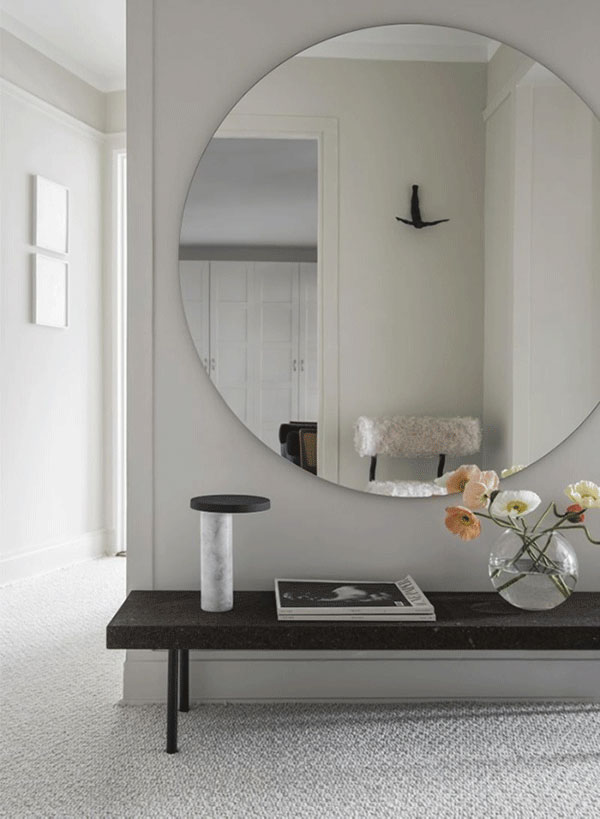interior-cravings-round-mirror-over-bench-in-entryway-design-by-hanna-wessman-via-thedesignchaser