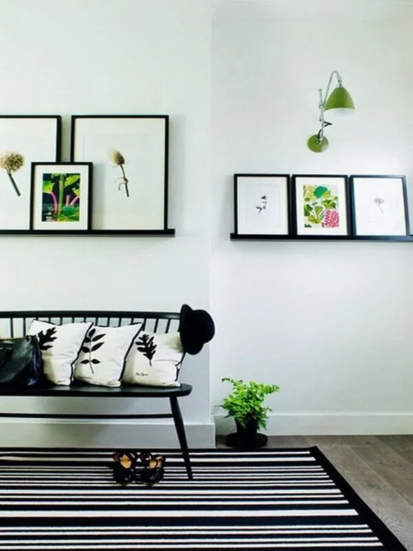 A hallway or entryway is the perfect spot to display some pictures. Try fitting the ledges at a variety of heights in order to create a visual wall.