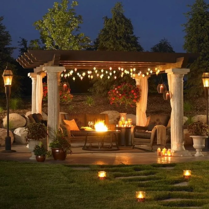 A very nice outdoor patio setup with a huge pergola