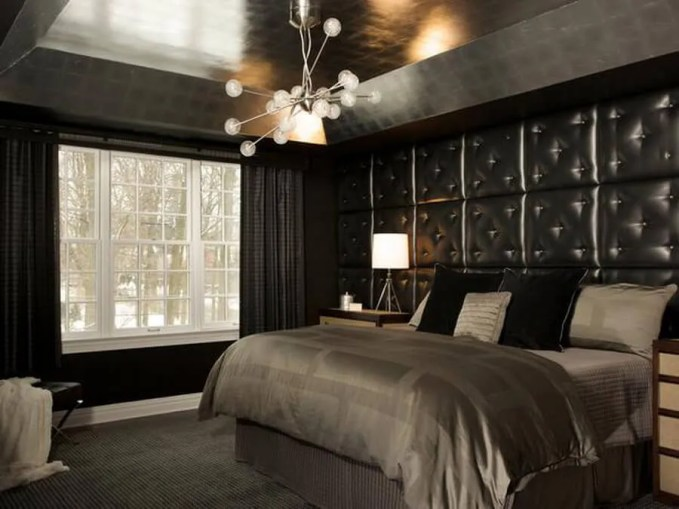 Bold, Black Bedroom With Tufted Leather Headboard