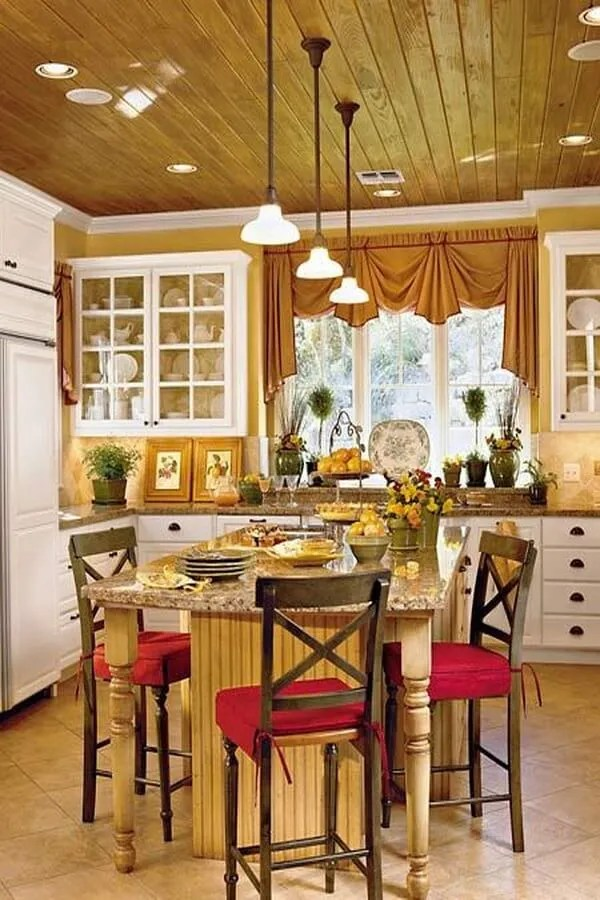 Love the wood ceilings, the yellow walls, and the white, red, and green accents.