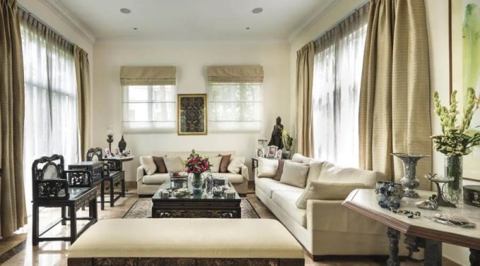 the living room is an eclectic mix of heirloom collectibles, antique furniture and new finds