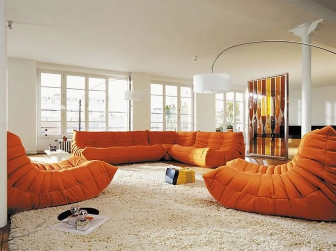 White-Living-Room-Furniture-For-Interior-Design-With-Cool-Orange-Togo-Sofa-White-Artistic-Arch-Lamps-Spacious-Living-Room-Cream-Rug-Tiny-Coffee-Table