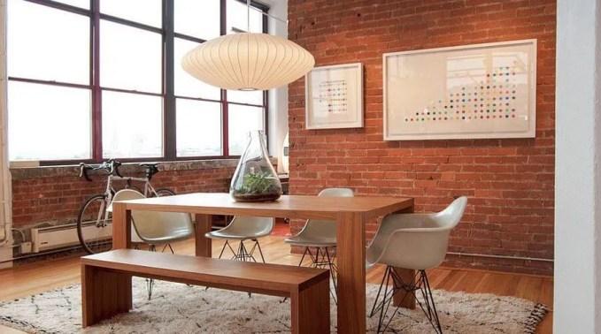 Cozy Dinign Room with Brick Walls