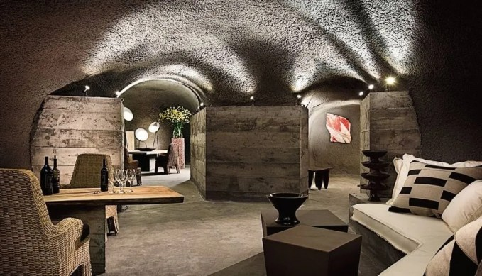 Cave Inspired Dining Room with Concrete Walls