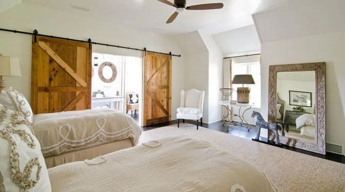 Sliding-barn-doors-add-texture-to-the-cool-bedroom
