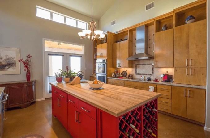 Red kitchen island with wine rack storage
