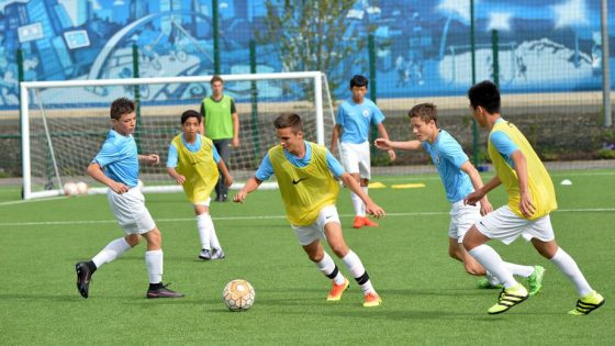 Children of different nationalities, aged 9-17, take part in a Football and English Language program at Manchester City Football Academy. Picture date: Friday August 5, 2016.