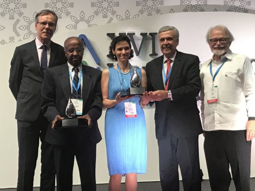 Dr. Salman M.A. Salman and Dr. Cecilia Tortajada accepting the Crystal Drop Award, presented by IWRA President Patrick Levarde (far left), Past President Ben Braga, and Awards Chairman James Nickum (far right)