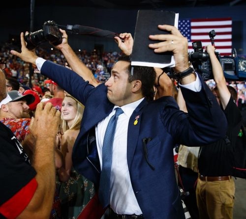 """39352806 265060234132868 8350276194272280576 n 500x446 A volunteer member of the advance team for #president #donaldtrump blocks the lens of a photographer trying to take a photo of a…"""""""